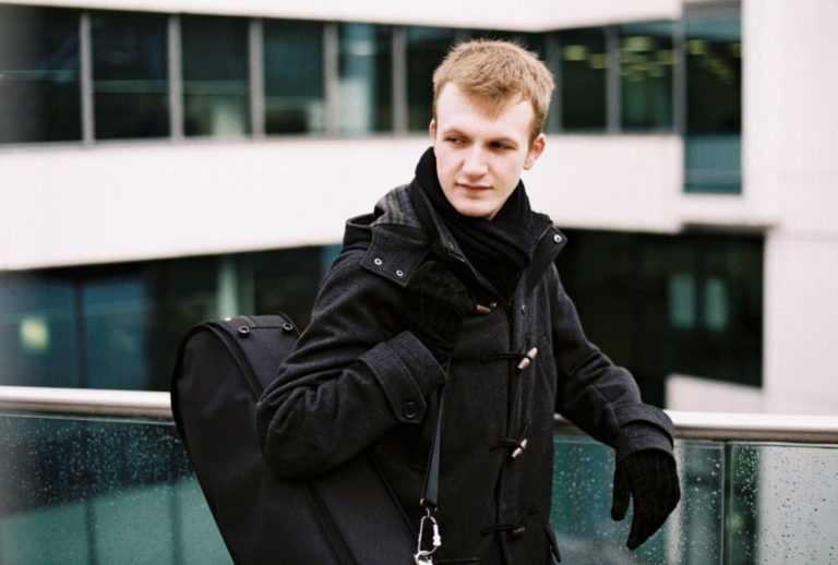 Martin Moriarty Standing with Viola Case Over Shoulder